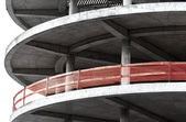 Red fence on modern industrial building under construction — Stock Photo