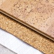 Stock Photo: Laying technology of cork floor on concrete base