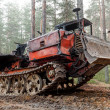 Experienced rusty all-terrain vehicle on tracks — Stock Photo