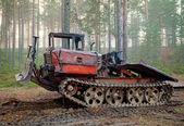 Old rusty all-terrain vehicle on tracks — Stock Photo