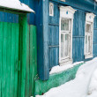 Winter street with wooden old rural houses — Stock Photo