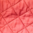 Background texture of quilted red blanket fabric — Stock Photo