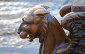 Griffin - bronze winged lion on the University Embankment, St. Petersburg — Stock Photo