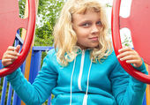 Little active blond girl on playground — Stock Photo