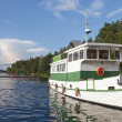 Small white pleasure boat moored on Saimaa lake — Foto Stock