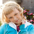 Little beauty blond girl smiles — Stock Photo