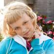 Little beauty blond girl smiles — Stock Photo