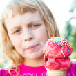 Little girl with big fruit ice-cream in the park — Stock Photo