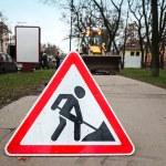 Roadworks sign on the asphalt urban lane — Stock Photo #15730389