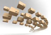 Stream of flying cardboard boxes — Stock Photo