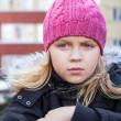 Royalty-Free Stock Photo: Little beauty blond girl looks thoughtfully into the distance