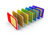 Stack of colorful phone SIM cards isolated on white background with shadow — Stock Photo