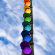 Seven-color rainbow scheme traffic light concept above blue sky — Stock Photo