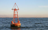 Floating old red buoy — Stock Photo