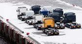 Trucks waits on snowbound pier in port — Stock Photo