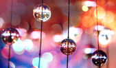 Abstract colorful background with glass spherical design elements of modern chandelier and natural lens bokeh pattern — Stock Photo