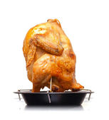 Whole grilled chicken on black metal pan isolated on white background — Stock Photo