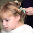 Little blond Russian girl with curlers on hair — Stock Photo