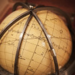 Vintage travel star sky globe in wooden box - Stock Photo