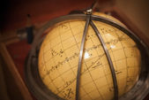 Ancient travel star sky globe in wooden box — Stock Photo