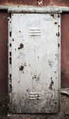 Old metal door texture with gray cracked painting — Stock Photo