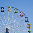 Ferris wheel on a bright sunny day - Stock Photo