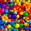 Background with multicolored random sized plastic mosaic pins — Stock Photo