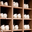 Bowling shoes on racks — Stock Photo