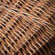 A wicker basket close-up photo texture with shallow depth of fie - Stock Photo
