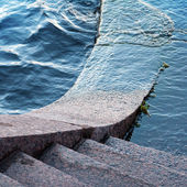 Typically stone steps down to the Neva river in St.Petersburg. W — Stock Photo