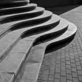Seven curved footsteps of modern stairs — Stock Photo