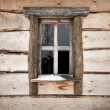 Stock Photo: Old wooden building facade texture with small window
