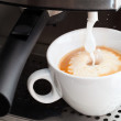 Stock Photo: Coffee maker pouring hot milk foam to prepare cappuccino