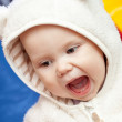 Little baby laughs with open mouth — Stock fotografie