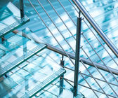 Modern interior abstract fragment with steel railings and stairs made of glass — Stock Photo