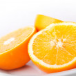 Sliced fresh orange fruit on white background — Stock Photo