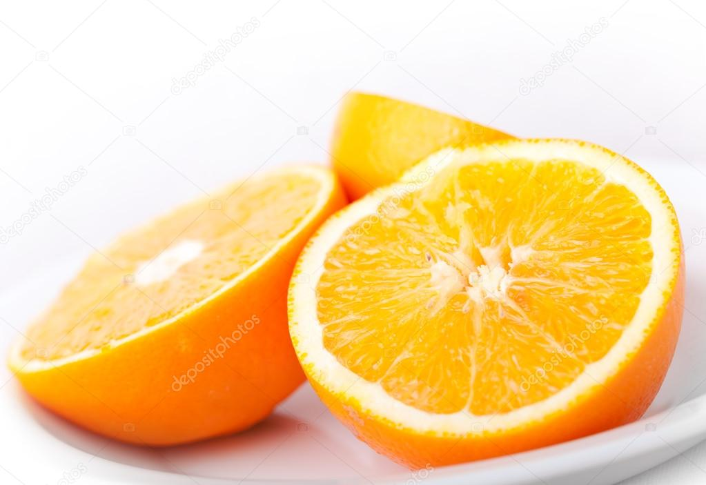 Sliced fresh orange fruit on white background — Stock Photo #18740387