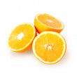 Sliced fresh orange fruit isolated on white background — Stock Photo