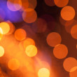 Abstract background with orange lights bokeh — Stock Photo #18904427