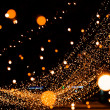 Abstract background with garland lights bokeh in dark — Stock Photo #18904429
