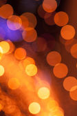 Abstract background with orange lights bokeh — Stock Photo