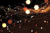 Abstract blurred background with orange garland lights bokeh — Stock Photo