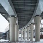 Urban scene with bottom view of steel automotive bridge — Stock Photo