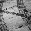 Tire tracks and footstep on the asphalt urban road — Stock Photo