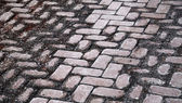 Background texture of damaged old cobblestone road — Stock Photo