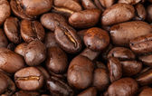 Macro background texture of roasted coffee beans — Stock Photo