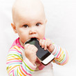 Little baby in casual colorful striped clothing holds mobile phone — Stock Photo
