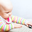 Little baby in casual colorful striped clothing with mobile phone — Stock Photo