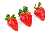 Three bright fresh strawberries isolated on white — Stock Photo