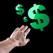 Green shiny USA dollar sign and man's hand over black background — Stock Photo